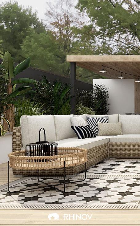 un tapis extérieur aux motifs géométriques terrasse devant maison